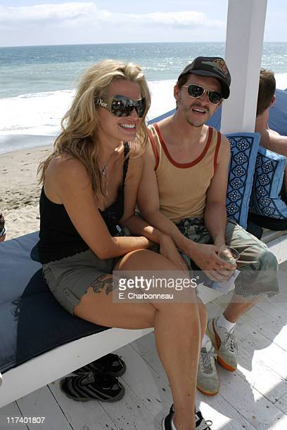 Amanda Tosch and Clifton Collins Jr during 10 CANE RUM and ALTERNA Party Hosted By Rosario Dawson For Voto Latino at Polaroid Beach House in Malibu...