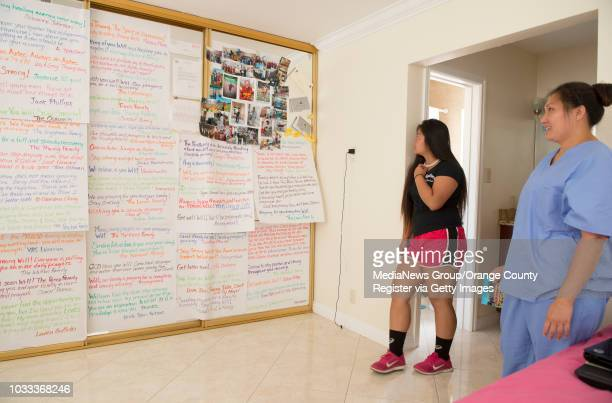 Amanda Truong left and her mother Vanessa Nguyen look a wall of get well messages and photos for Will Truong as he recovered from breaking his neck...