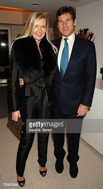 Amanda Wakeley and a guest attend the exhibit of Aston Martin automobiles featured in James Bond movies at the Serpentine Gallery on November 9 2006...