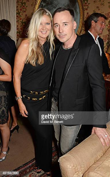 Amanda Wakeley and David Furnish attend Tracey Emin's birthday party at Mark's Club on July 3 2014 in London England