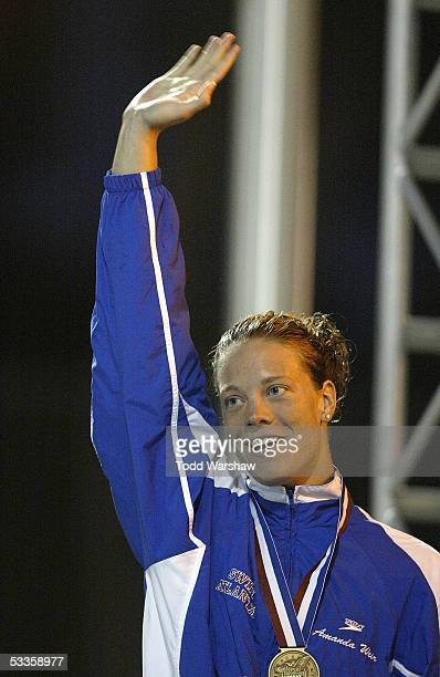 Amanda Weir celebrates after winning the championship final of the 50 meter freestyle at the ConocoPhillips National Championship on August 7, 2005...