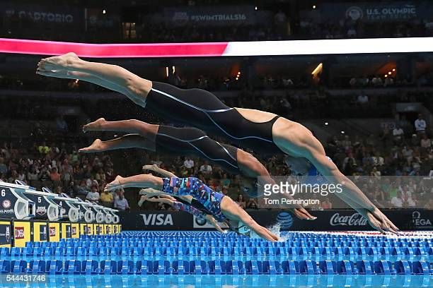 Amanda Weir Lia Neal Katrina Konopka Madison Kennedy and Abbey Weitzeil of the United States dive in to compete in the final heat for the Women's 50...