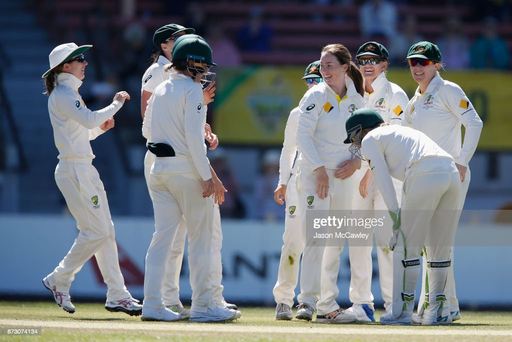 Amanda Wellington of Australia celebrates with team mates after dismissing Tammy Beaumont of England during day four of the Women's Test match between Australia and England at North Sydney Oval on November 12, 2017 in Sydney, Australia.