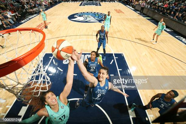 Amanda Zahui B #17 of the New York Liberty and Cecilia Zandalasini of the Minnesota Lynx reach for the rebound on July 24 2018 at Target Center in...