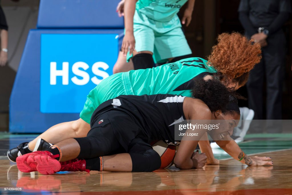 Amanda Zahui B. #17 of the New York Liberty and Kelsey Bone #3 of the Las Vegas Aces wrestle for the ball drug the game on June 13, 2018 at Westchester County Center in White Plains, New York.