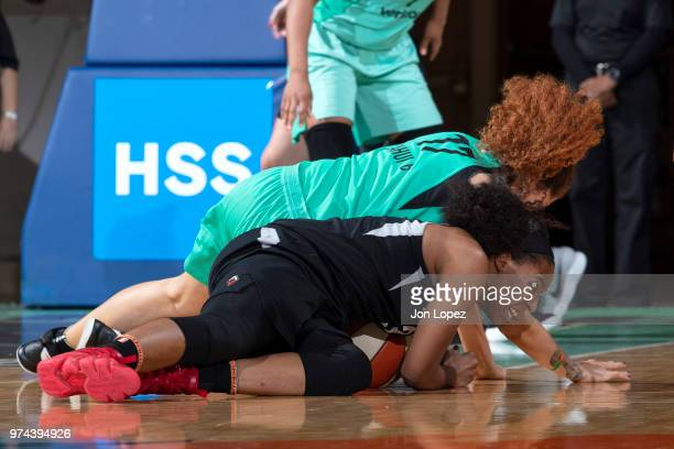 Amanda Zahui B #17 of the New York Liberty and Kelsey Bone of the Las Vegas Aces wrestle for the ball drug the game on June 13 2018 at Westchester...