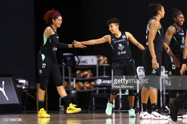 Amanda Zahui B high-fives Layshia Clarendon of New York Liberty during the game on August 7, 2020 at the Feld Entertainment Center, in Palmetto,...