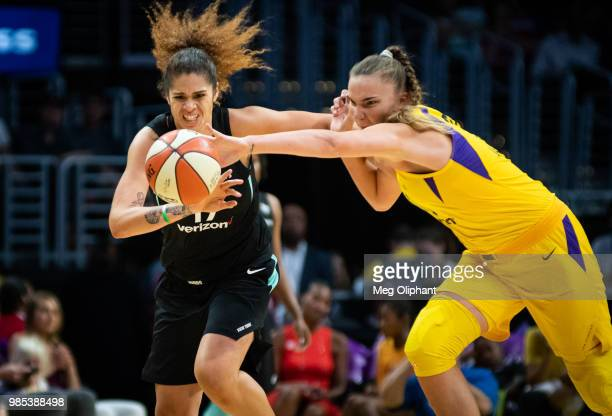 Amanda Zahui B of the New York Liberty and Maria Vadeeva of the Los Angeles Sparks reach for the ball during the game at Staples Center on June 24...