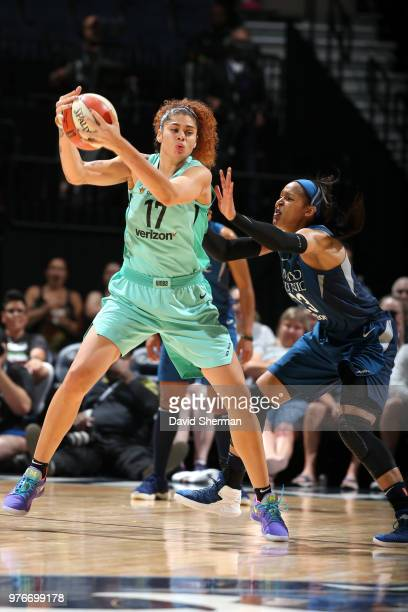 Amanda Zahui B of the New York Liberty handles the ball against Maya Moore of the Minnesota Lynx on June 16 2018 at Target Center in Minneapolis...