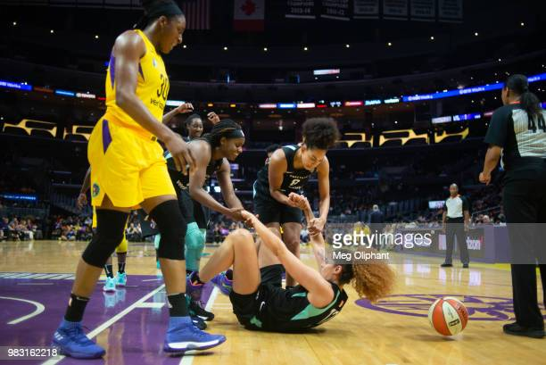 Amanda Zahui B of the New York Liberty is helped up by teammates in the LA Sparks game at Staples Center on June 24 2018 in Los Angeles California...