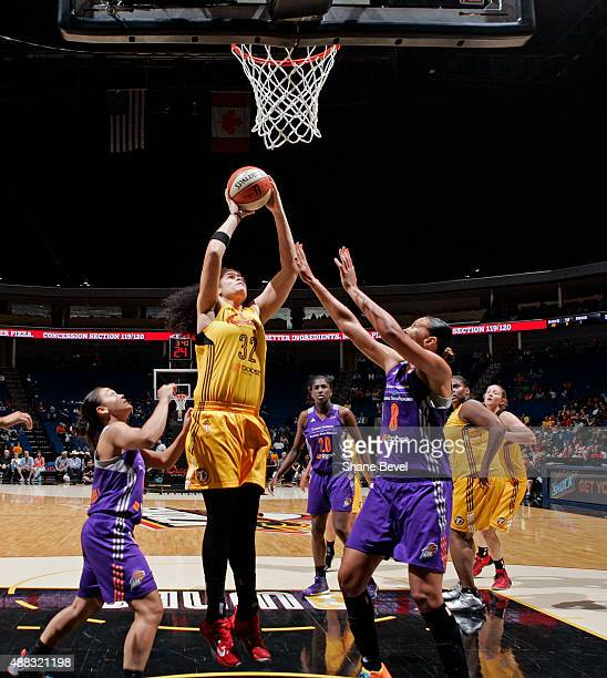 Amanda Zahui B of the Tulsa Shock grabs a rebound against the Phoenix Mercury on September 13 2015 at the BOK Center in Tulsa Oklahoma NOTE TO USER...
