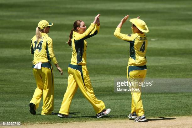 AmandaJade Wellington of Australia celebrates with teammates after getting the wicket of Liz Perry of New Zealand during the Women's Twenty20...