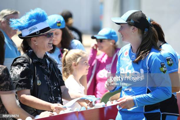 AmandaJade Wellington of the Adelaide Strikers signs autographs during the Women's Big Bash League WBBL match between the Strikers and the Hurricanes...