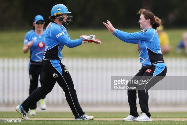AmandaJade Wellington of the Strikers celebrates a wicket with Tegan McPharlin during the Women's Big Bash League match between the Melbourne...
