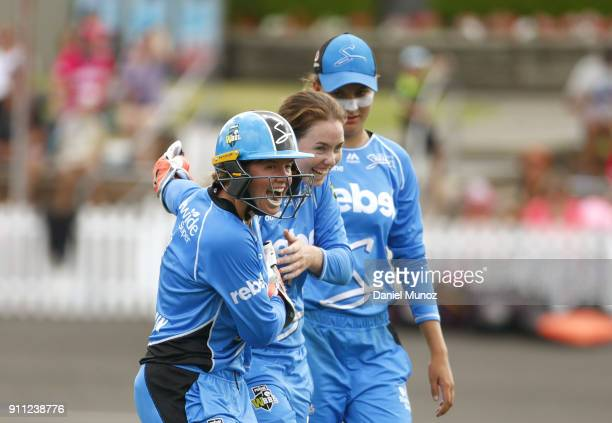 AmandaJade Wellington of the Strikers is congratulated by Tegan McPharlin after taking the wicket of Ellyse Perry of the Sixers during the Women's...
