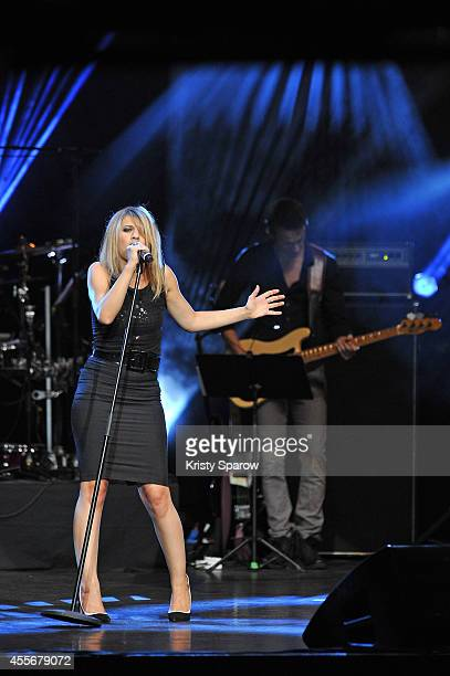Amandine Bourgeois performs onstage during 'Leurs Voix Pour L'Espoir 2014' concert at L'Olympia on September 18 2014 in Paris France