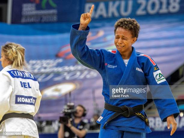 Amandine Buchard of France is highly emotional after defeating Charline Van Snick of Belgium by a wazari in extra-time to win the u52kg bronze medal...