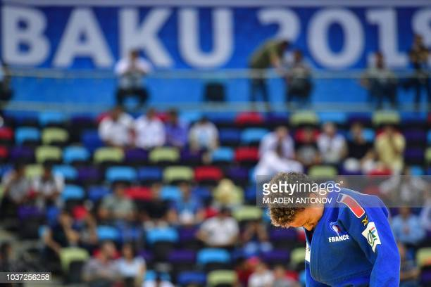 Amandine Buchard of France reacts during her fight against Charline Van Snick of Belgium in the under 52kg women category of the 2018 Judo World...