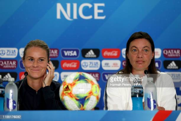 Amandine Henry and Corinne Diacre head coach of France answer questions from the media during a press conference at Stade de Nice on June 11 2019 in...