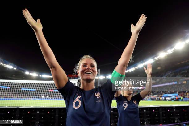 Amandine Henry and Eugenie Le Sommer of France celebrate with the fans following the 2019 FIFA Women's World Cup France group A match between France...