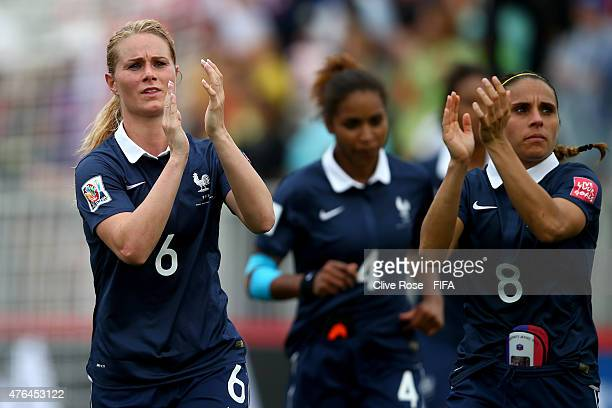 Amandine Henry and Jessica Houara of France celebrate at the end of the FIFA Women's World Cup 2015 Group F match between France and England at the...