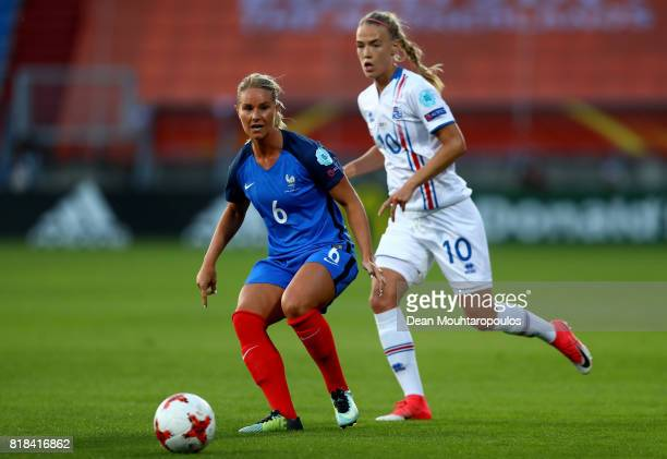 Amandine Henry of France and Dagný Brynjarsdóttir of Iceland compete for the ball during the Group C match between France and Iceland during the UEFA...