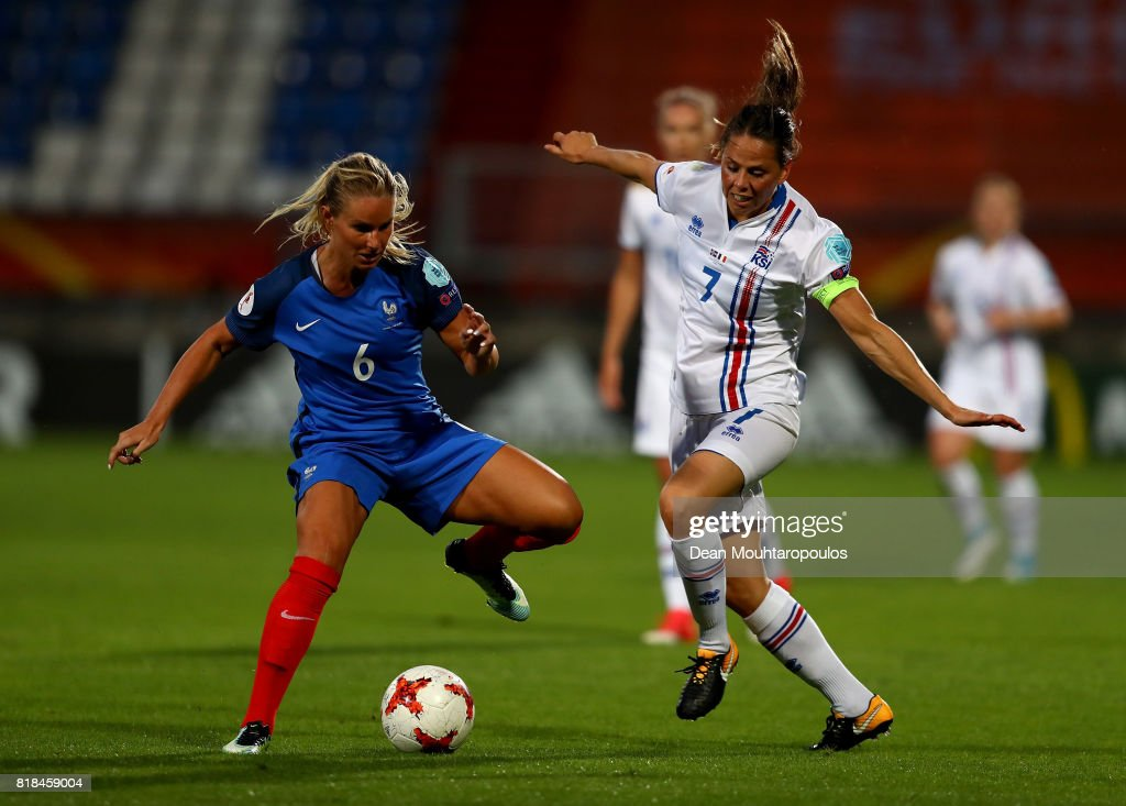 Amandine Henry (L) of France and Sara Bjork Gunnarsdóttir of Iceland compete for the ball during the Group C match between France and Iceland during the UEFA Women's Euro 2017 at Koning Willem II Stadium on July 18, 2017 in Tilburg, Netherlands.