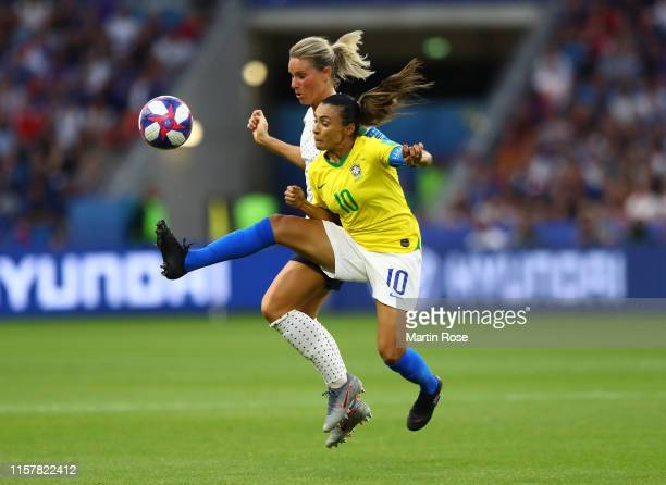 Amandine Henry of France battles for possession with Marta of Brazil during the 2019 FIFA Women's World Cup France Round Of 16 match between France...