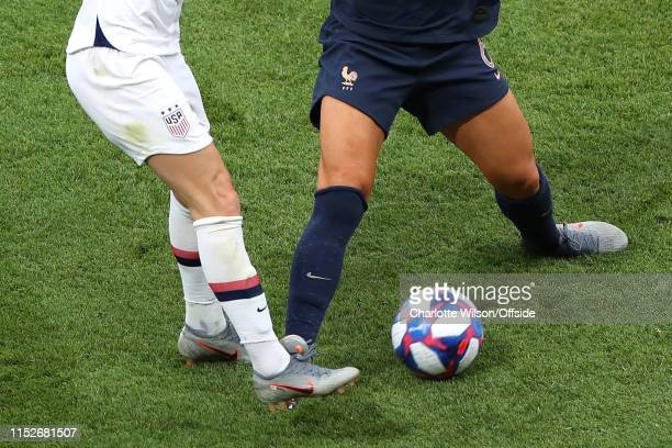 Amandine Henry of France catches the ankle of Megan Rapinoe of USA during the 2019 FIFA Women's World Cup France Quarter Final match between France...
