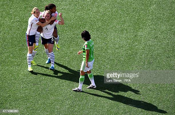 Amandine Henry of France celebrates with team mates Sabrina Delannoy of France and Elodie Thomis of France after scoring her teams fifth goal during...