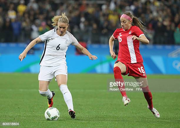 Amandine Henry of France is chased by Janine Beckie of Canada during the Women's Football Quarter Final match between Canada and France on Day 7 of...
