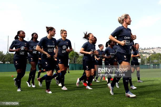 Amandine Henry of France leads the team for a warm up during a training session at Stade CharlesEhrmann on June 10 2019 in Nice France