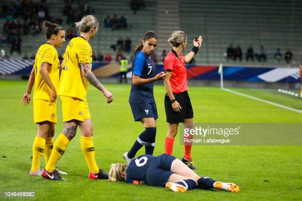 Amandine Henry of France leave the pitch injured and Ivana Martincic referee during the Women's International Friendly match between France and...