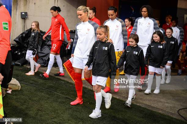 Amandine HENRY of France Sarah BOUHADDI of France and Wendie RENARD of France enter on the pitch without giving their hands to the escort kids due to...