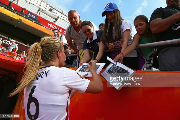 Amandine Henry of France signs autographs after the FIFA Women's World Cup 2015 Group F match between Mexico and France at Lansdowne Stadium on June...
