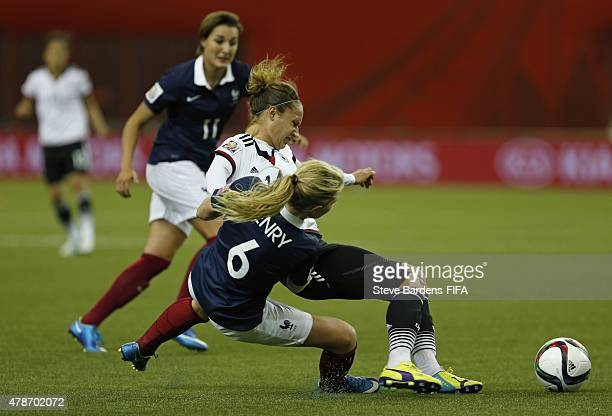 Amandine Henry of France tackles Babett Peter of Germany during the FIFA Women's World Cup 2015 quarter final match between Germany and France at...