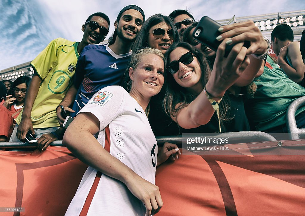 Amandine Henry of France takes a selfie with fans after the FIFA Women's World Cup 2015 Group F match between Mexico and France at Lansdowne Stadium on June 17, 2015 in Ottawa, Canada.