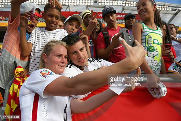 Amandine Henry of France takes a selfie with fans after the FIFA Women's World Cup 2015 Group F match between Mexico and France at Lansdowne Stadium...
