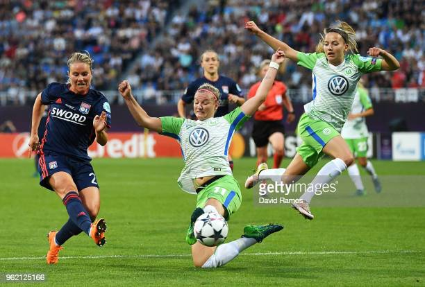 Amandine Henry of Lyon shoots past Alexandra Popp of Vfl Wolfsburg during the UEFA Womens Champions League Final between VfL Wolfsburg and Olympique...