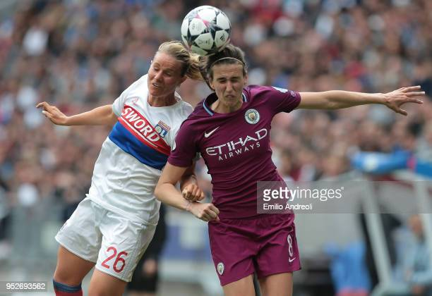 Amandine Henry of Olympique Lyonnais jumps for the ball against Jill Scott of Manchester City Women during the UEFA Women's Champions League Semi...