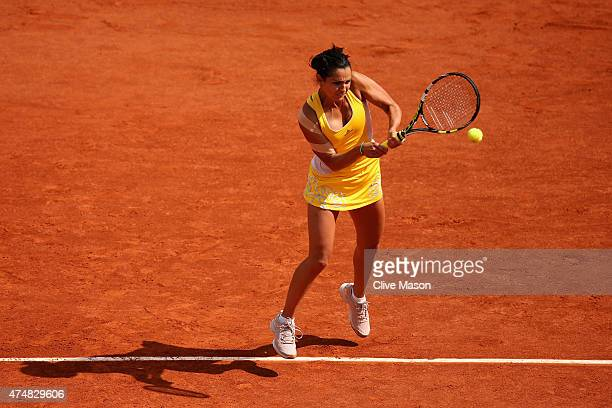 Amandine Hesse of France plays a backhand during her Women's Singles match against Samantha Stosur of Australia during day four of the 2015 French...
