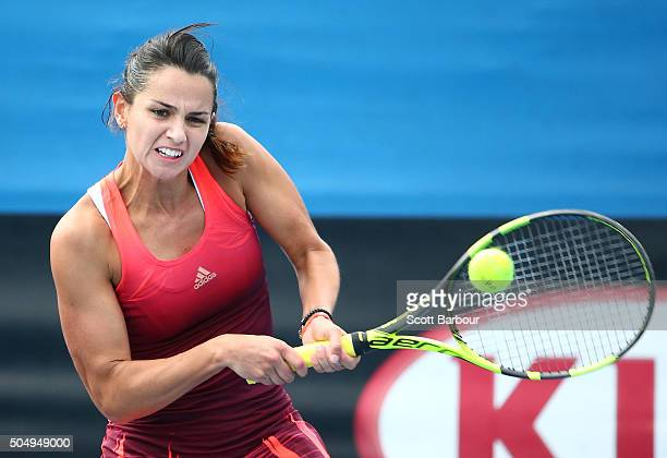 Amandine Hesse of France plays a backhand in her match against Kimiko DateKrumm of Japan during the first round of 2016 Australian Open Qualifying at...