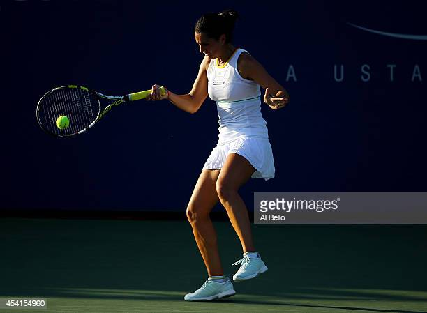 Amandine Hesse of France returns a shot against Alize Cornet of France during her women's singles first round match on Day One of the 2014 US Open at...