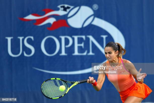 Amandine Hesse of France returns a shot during her first round Women's Singles match against Shuai Peng of China on Day One of the 2017 US Open at...