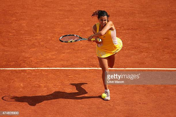 Amandine Hesse of France returns a shot during her Women's Singles match against Samantha Stosur of Australia during day four of the 2015 French Open...