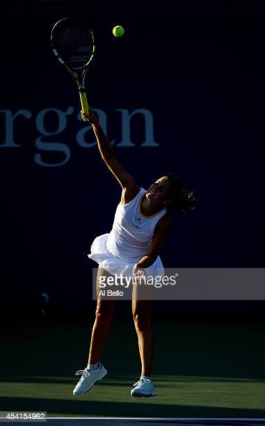 Amandine Hesse of France serves against Alize Cornet of France during her women's singles first round match on Day One of the 2014 US Open at the...