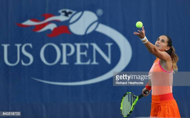 Amandine Hesse of France serves during her first round Women's Singles match against Shuai Peng of China on Day One of the 2017 US Open at the USTA...