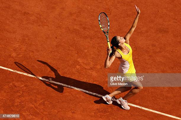 Amandine Hesse of France serves during her Women's Singles match against Samantha Stosur of Australia during day four of the 2015 French Open at...