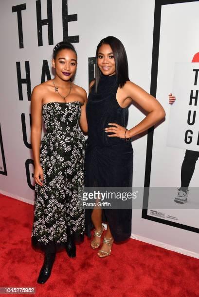 Amandla Stenberg and Regina Hall attend The Hate U Give Atlanta Red Carpet Screening at Regal Atlantic Station on October 3 2018 in Atlanta Georgia