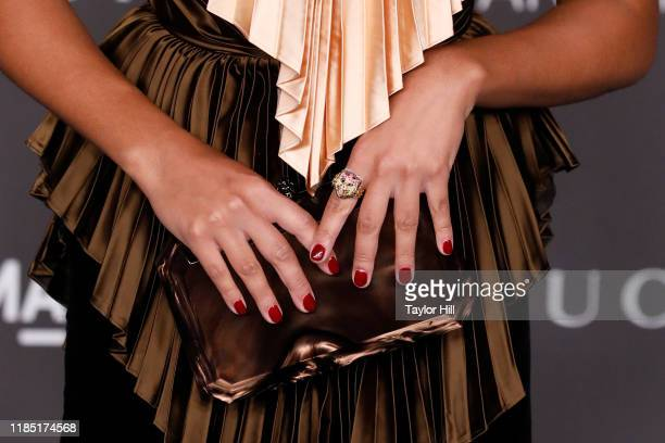 Amandla Stenberg clutch detail nail detail ring detail attends the 2019 LACMA Art Film Gala at LACMA on November 02 2019 in Los Angeles California